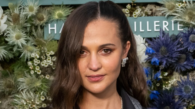 Alicia Vikander with floral background