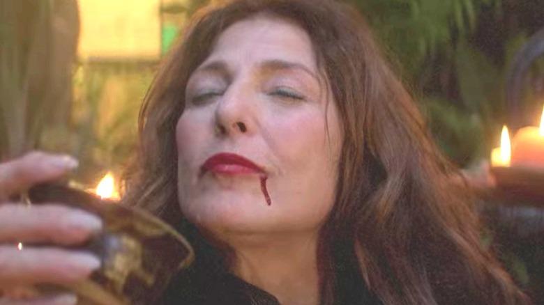 Catherine Keener drinking blood