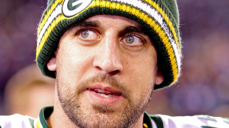 Aaron Rodgers looking to the side