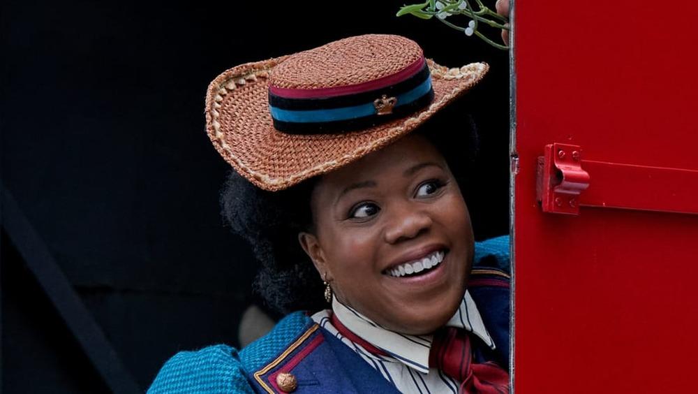 Lisa Davina Phillip behind the door of a mail truck
