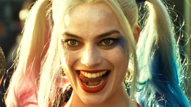 Harley Quinn licking teeth