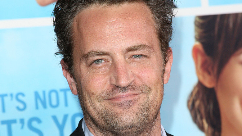 Matthew Perry grinning stubble