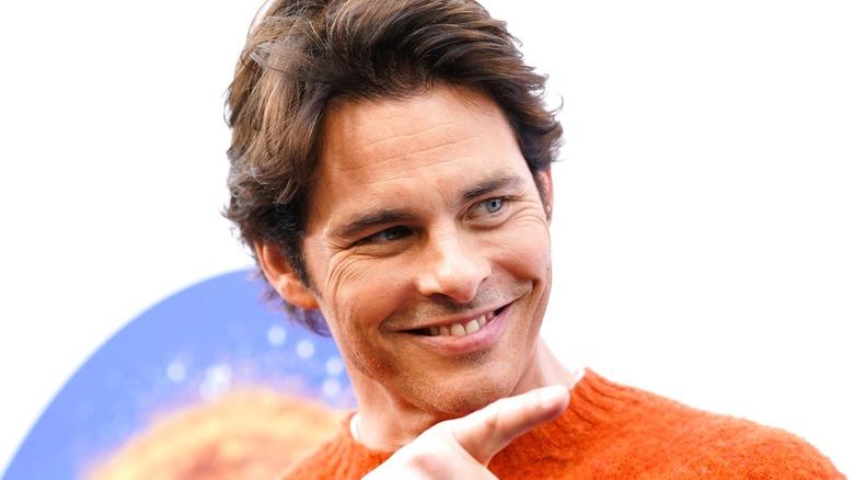 James Marsden wearing an orange sweater