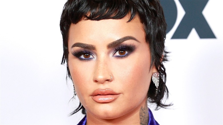 Demi Lovato with short black hair at Fox event