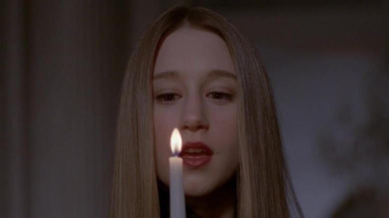Taissa Farmiga with candle