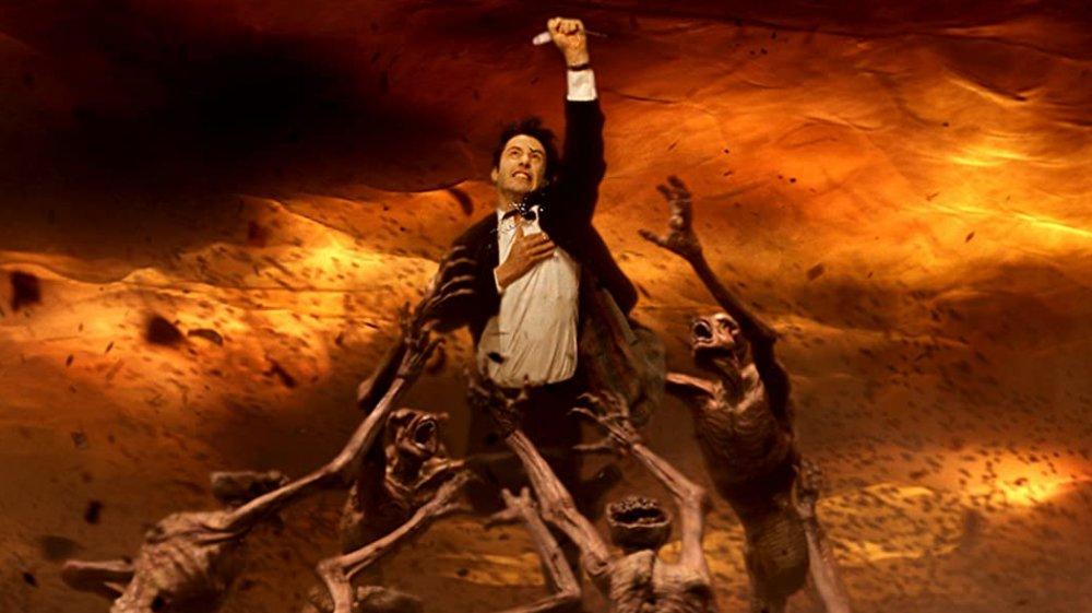 Keanu Reeves as Constantine in a hoard of demons