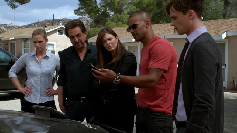 BAU Team looking at phone