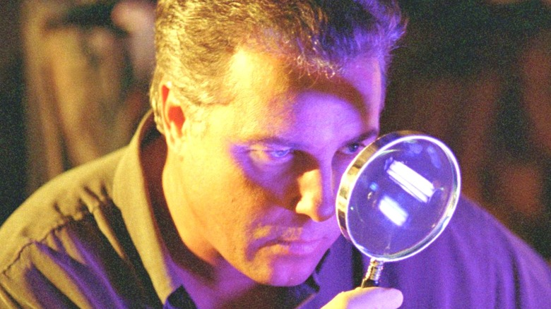 William Petersen with magnifying glass