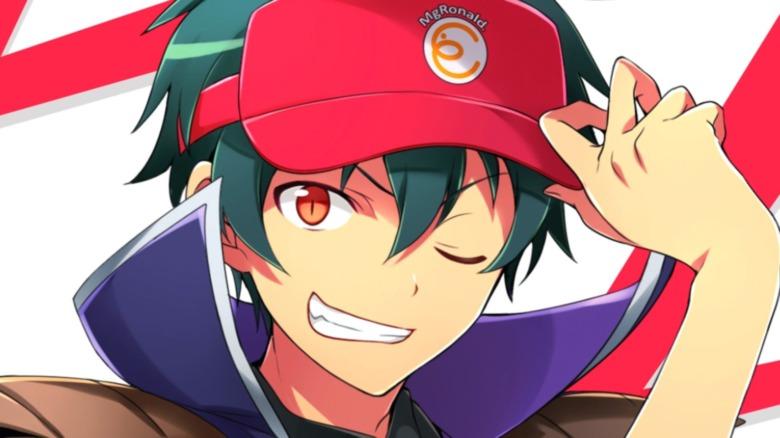 Sadao smiling and tipping cap
