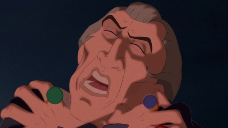 Frollo writhing with guilt