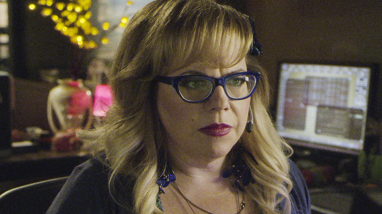 Penelope Garcia with headset