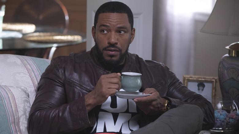 Laz Alonso drinking tea