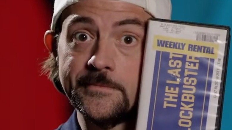 Kevin Smith holding blockbuster tape