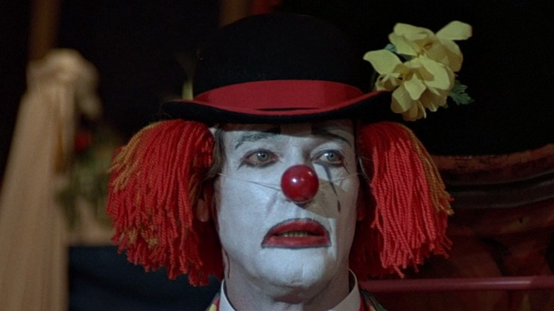 """Roger Moore as James Bond in clown makeup in """"Octopussy"""""""