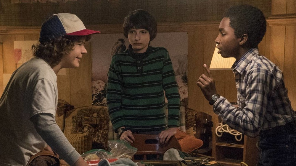 The central cast of characters play Dungeons & Dragons on Stranger Things