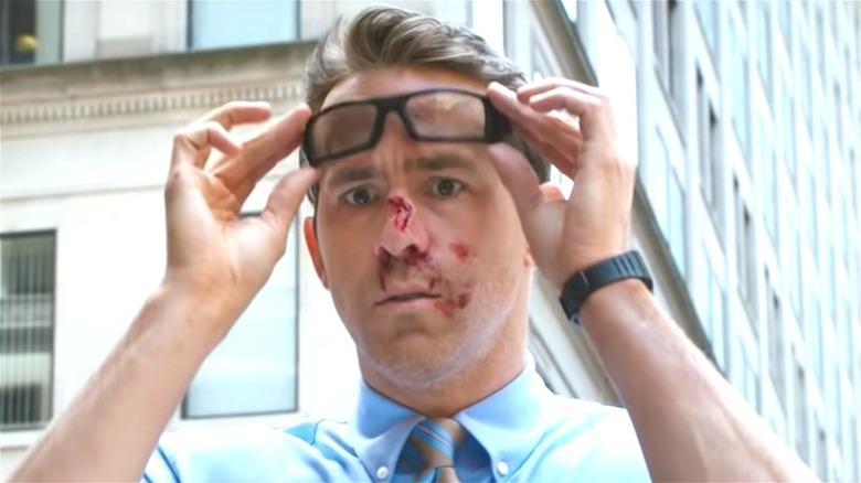 Ryan Reynolds as Guy wearing glasses in Free Guy
