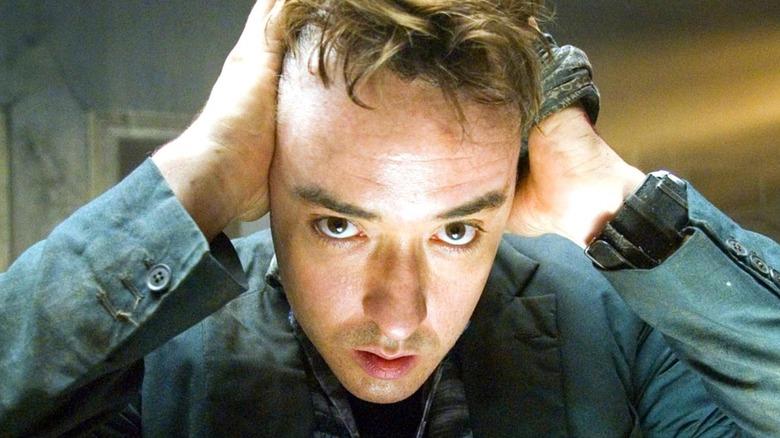 John Cusack as Mile pulling hair