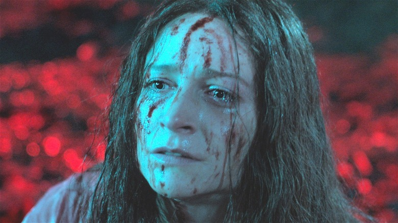 Enid Baines splattered with blood
