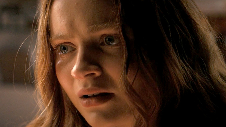 Sadie Sink stares in worry