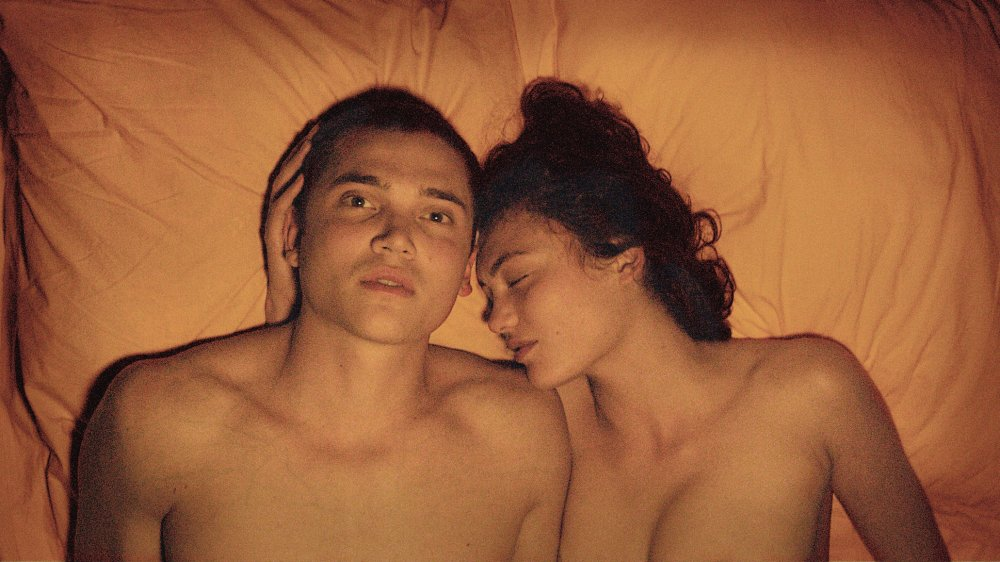Karl Glusman and Aomi Muyock as Murphy and Electra in Love