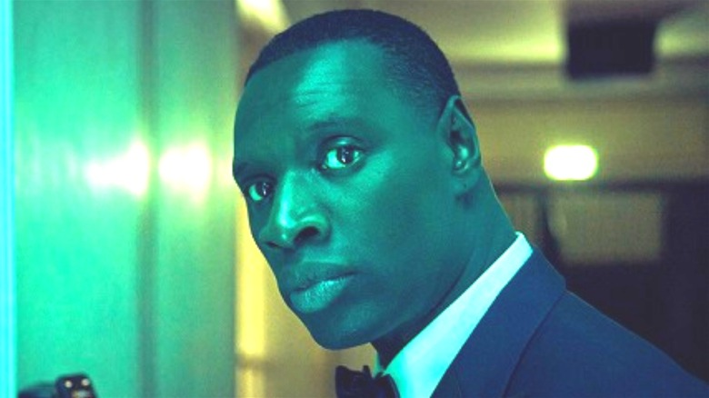 Diop in tuxedo and green light