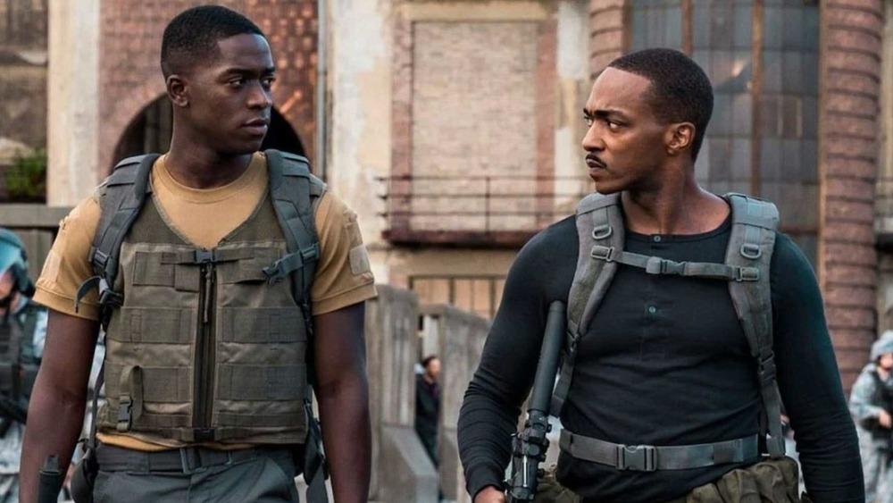Damson Idris and Anthony Mackie walking