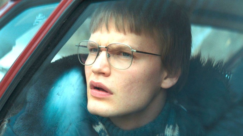 Magne looking out car window with glasses