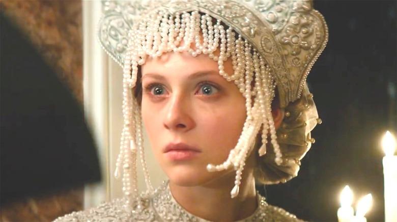 Alice in beaded headdress