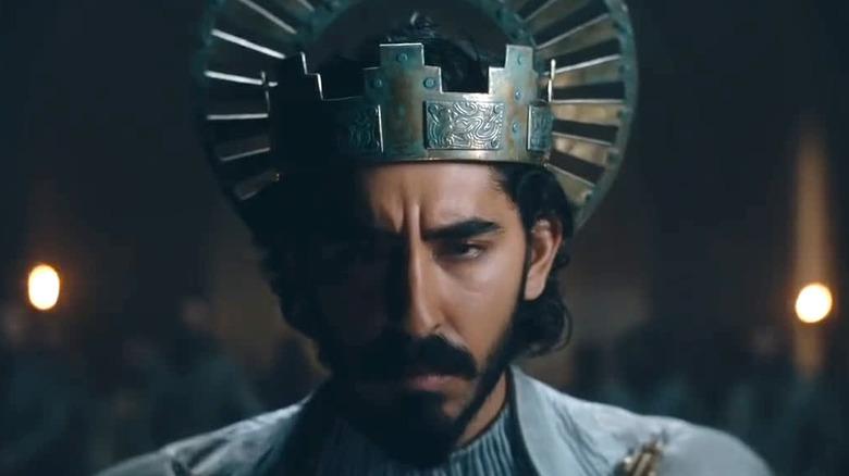 Dev Patel as Gawain wearing crown in The Green Knight