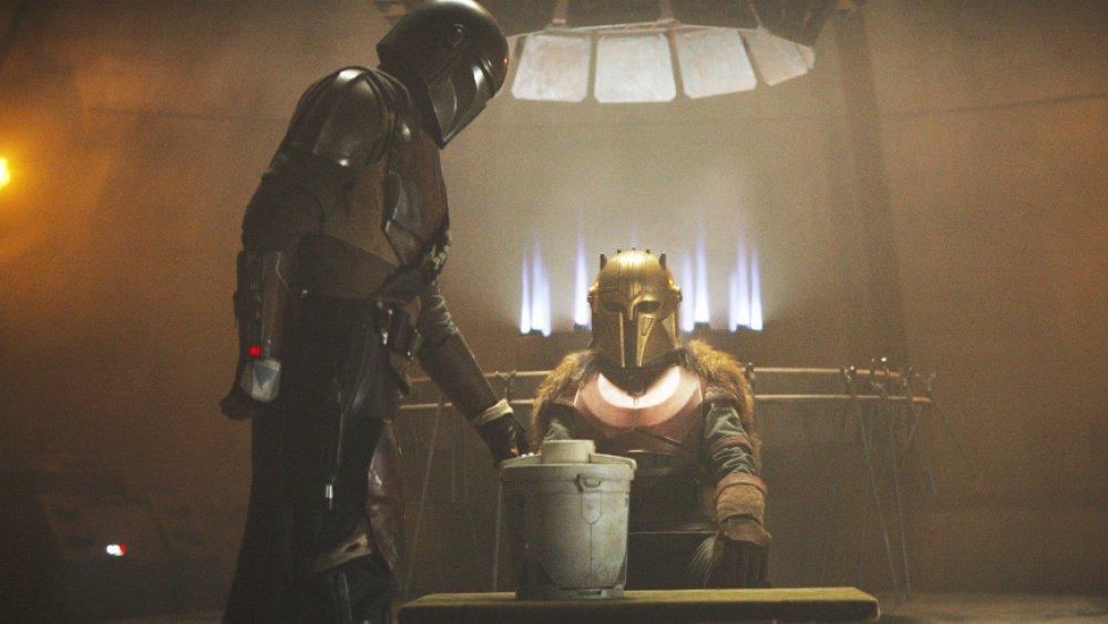 The Mandalorian brings his Beskar bounty to the blacksmith