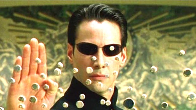 Keanu Reeves Neo stopping bullets