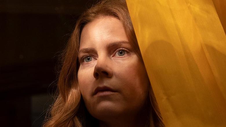 Amy Adams behind yellow curtain