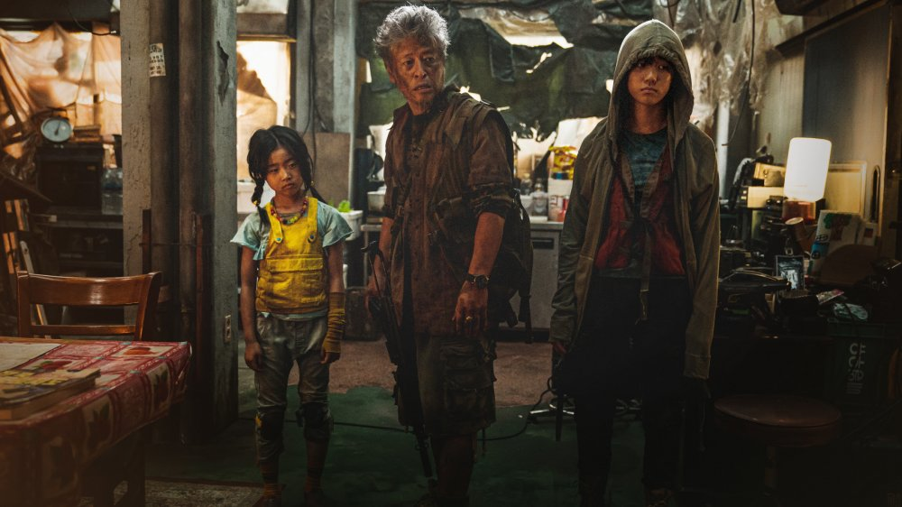 Kwon Hae-hyo as Old Man Kim with his daughters in Train to Busan Presents: Peninsula