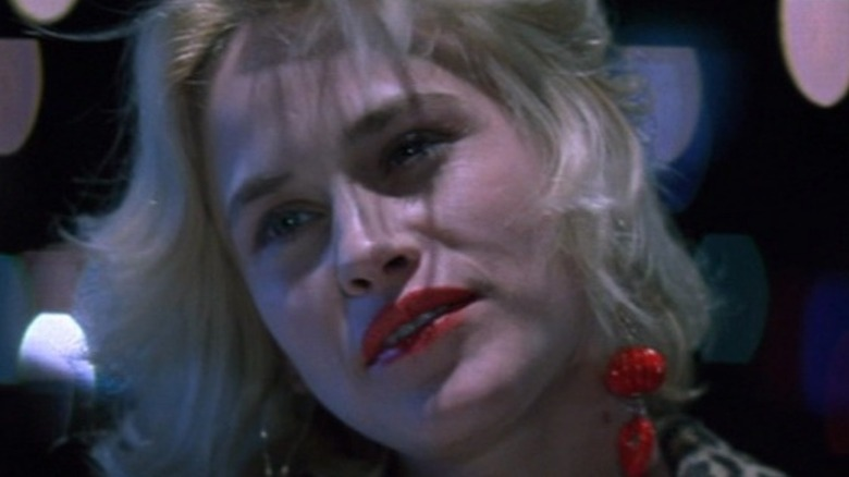 Patricia Arquette red lipstick and earrings