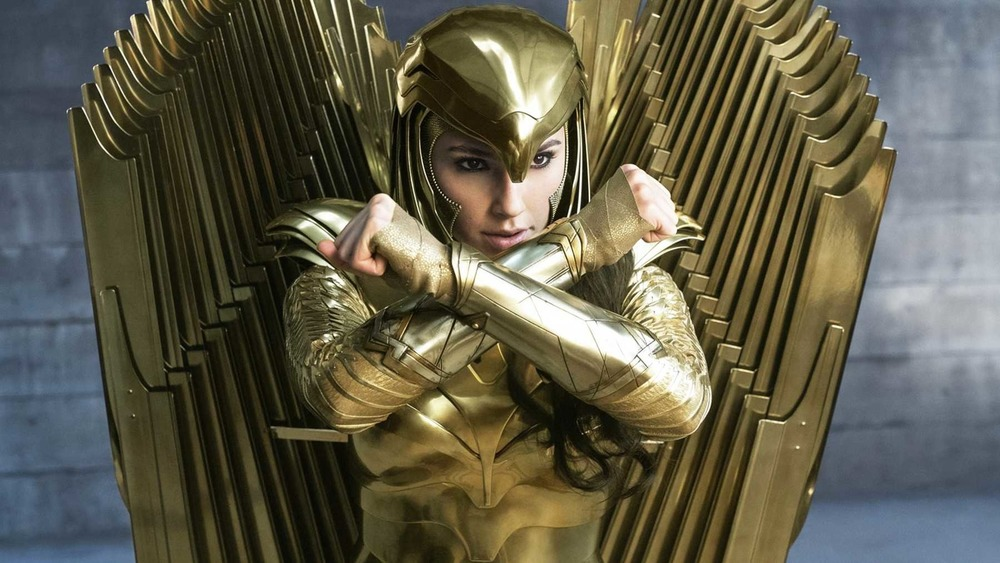 Wonder Woman in gold armor with arms crossed