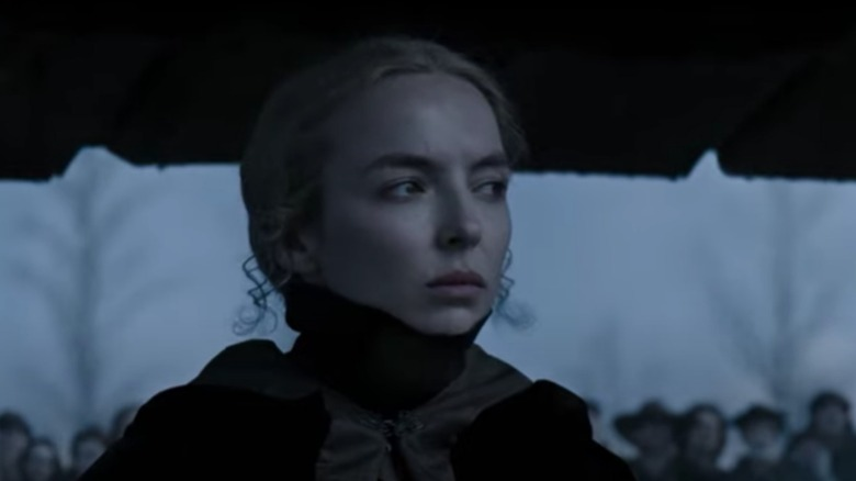 Jodie Comer in The Last Duel with black high collar attire