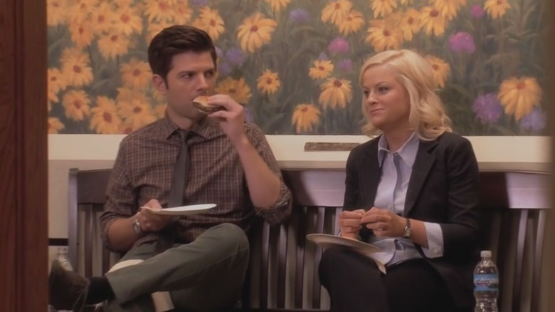 Adam Scott as Ben Wyatt and Amy Poehler as Leslie Knope on Parks and Recreation