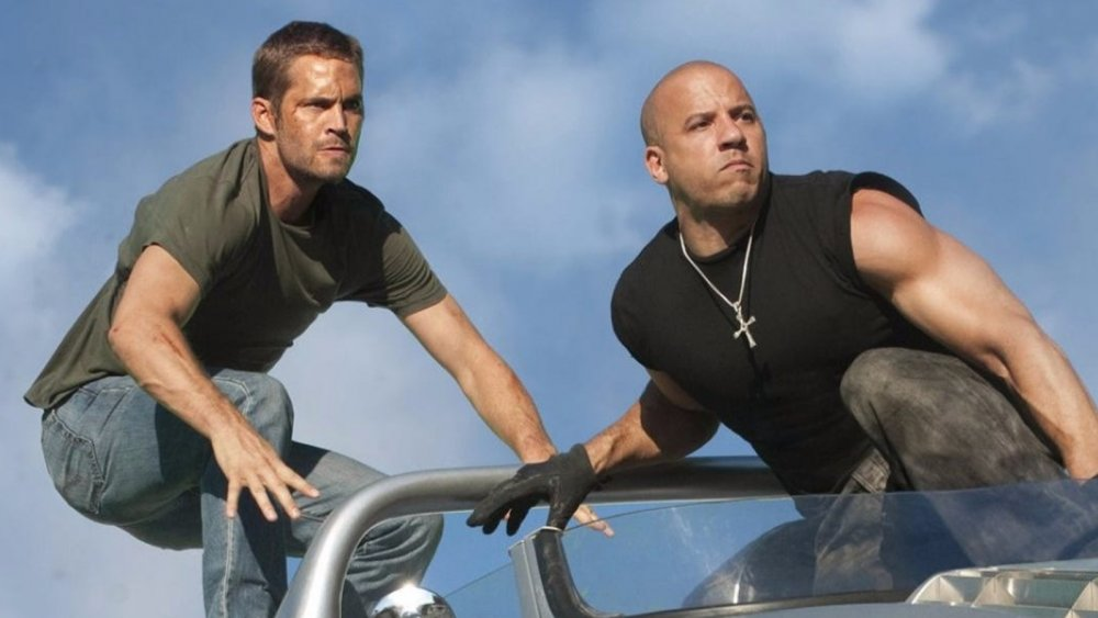 Vin Diesel as Dom Toretto and Paul Walker as Brian O'Conner in Fast and Furious
