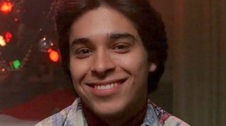 Fez smiling in front of Christmas lights