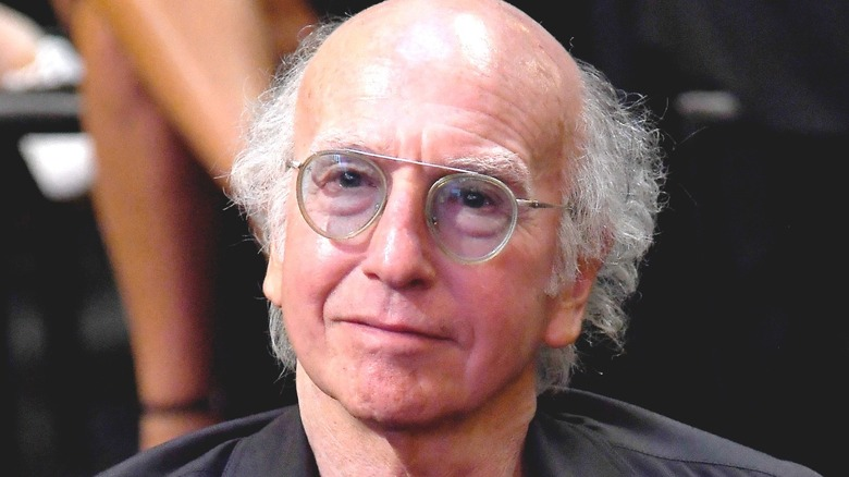 Larry David smirking