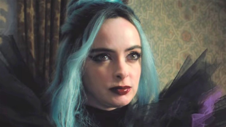Natacha (Krysten Ritter) with blue hair in Nightbooks
