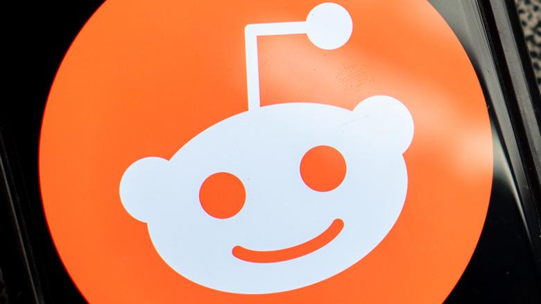 Reddit logo on a phone