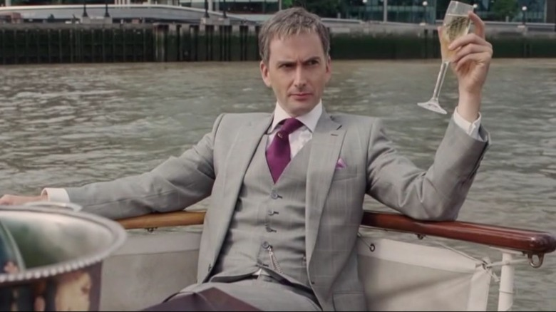 David Tennant drinks champagne on a boat in St. Trinian's