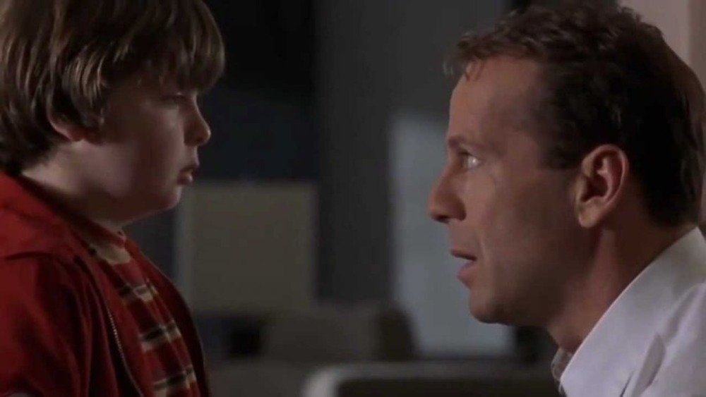 Russ (Bruce Willis) meets his younger self in Disney's The Kid