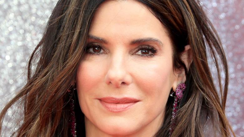 Sandra Bullock wearing purple earrings