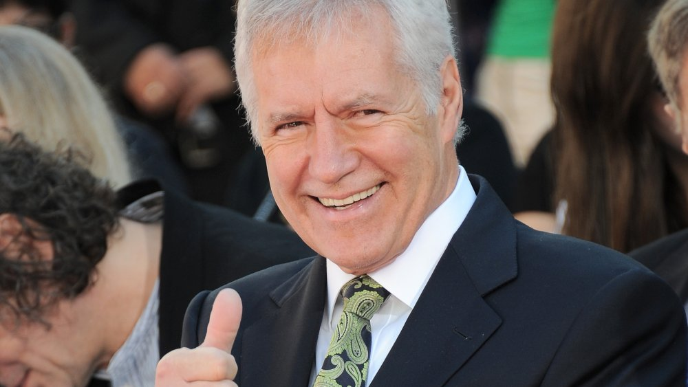 Alex Trebek giving a thumbs-up at a Hollywood Event