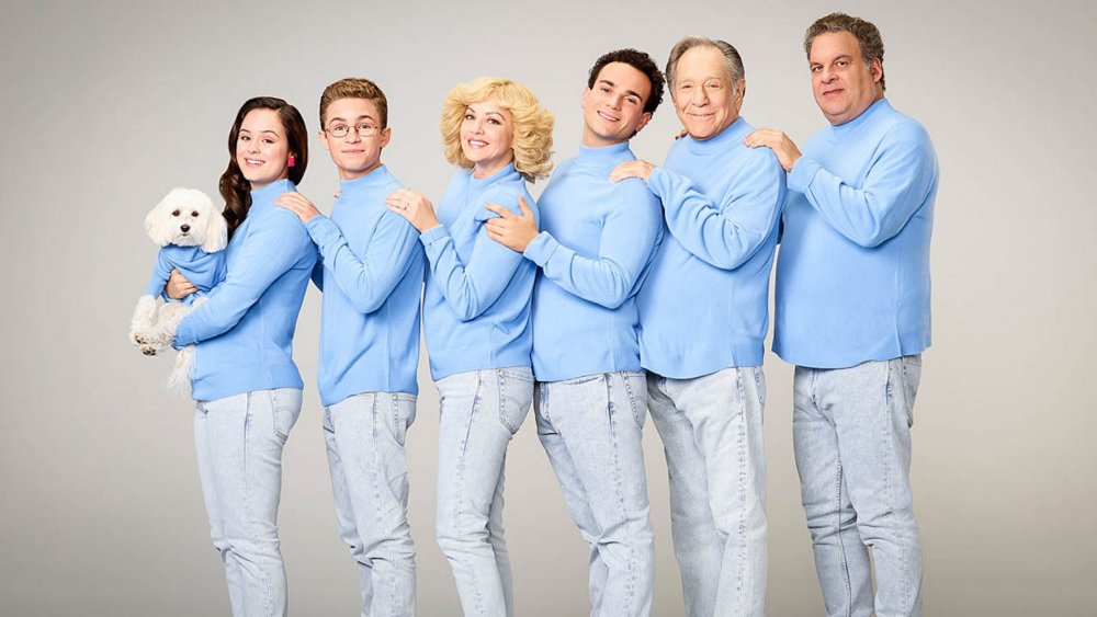 The cast of The Goldbergs posing for an awkward family photo