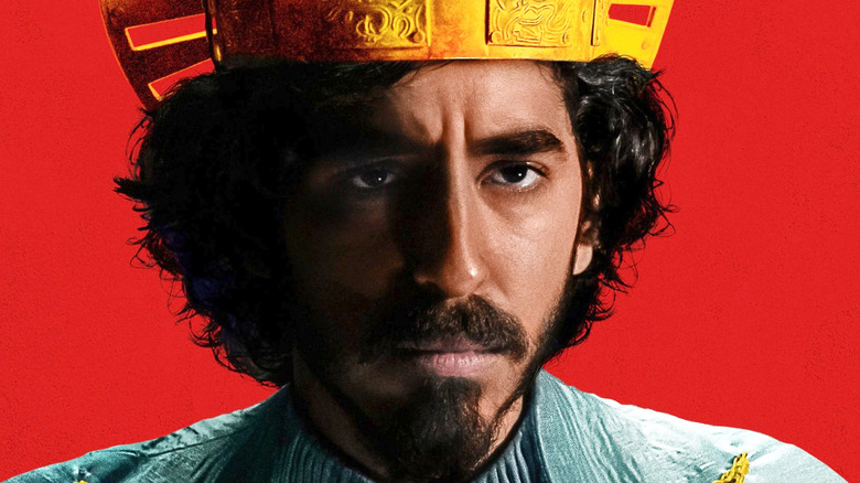Dev Patel The Green Knight red background