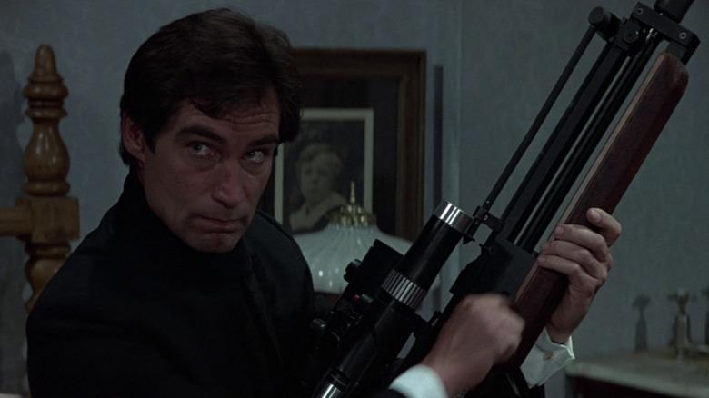 Timothy Dalton as James Bond holding gun