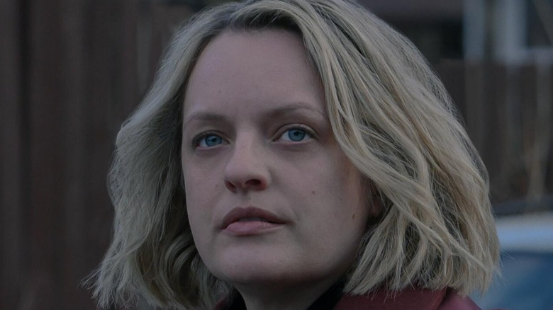 """Elisabeth Moss as June Osborne in the """"The Handmaid's Tale"""" Season 4 finale, looking pensively into the distance."""